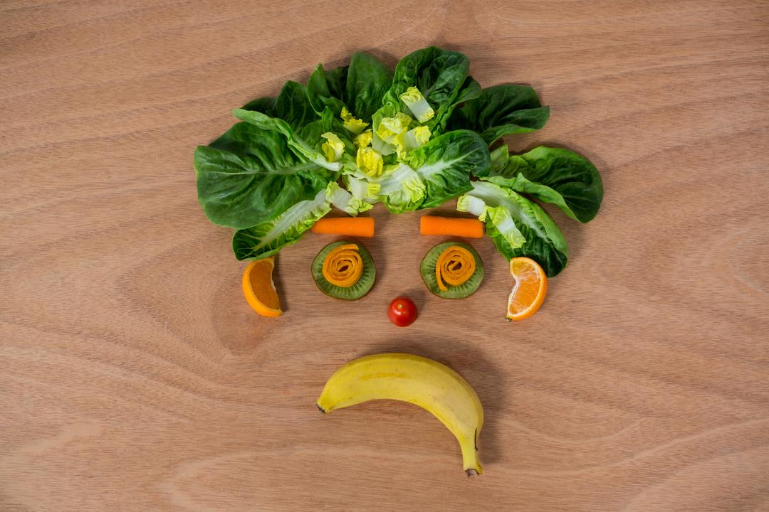 Sad face made of fruits and vegetables