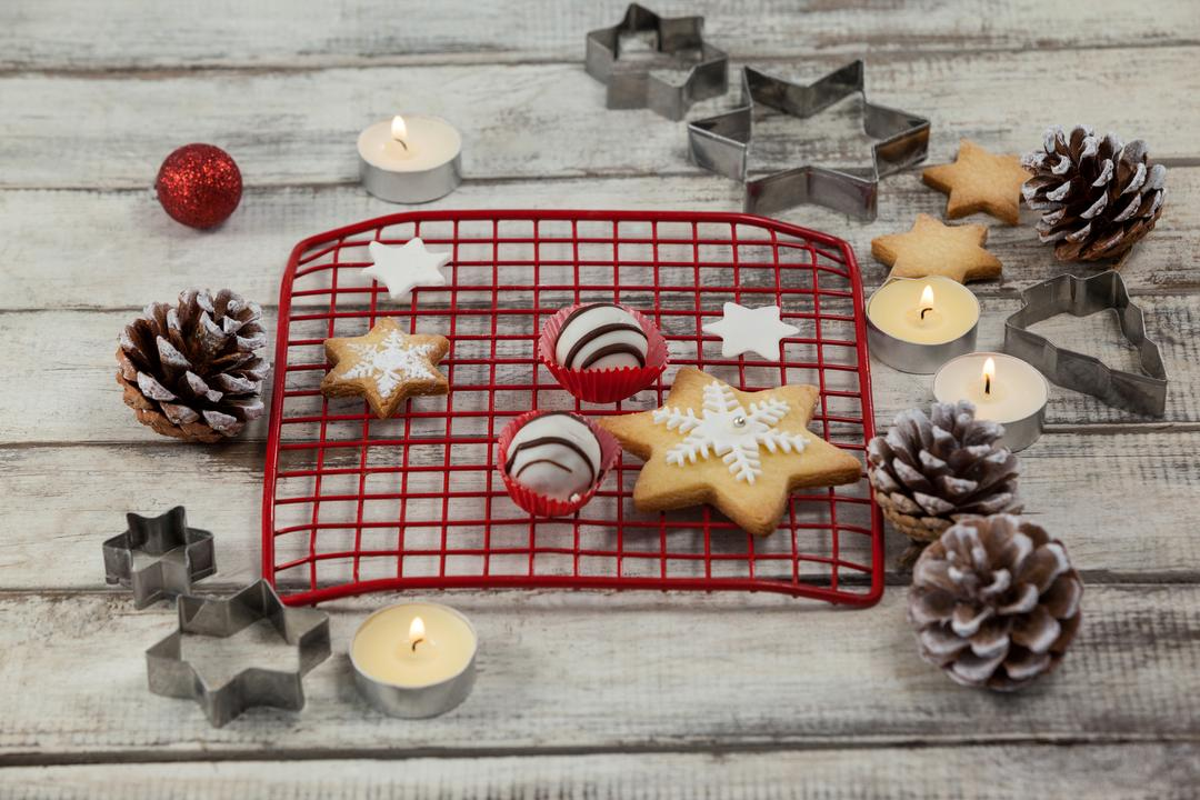 Christmas cookies with tealight candles on a plank