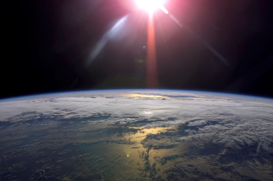 ISS013-E-78960 (9 Sept. 2006) --- A rising sun and Earth's horizon are featured in this image photographed by an Expedition 13 crewmember on the International Space Station.