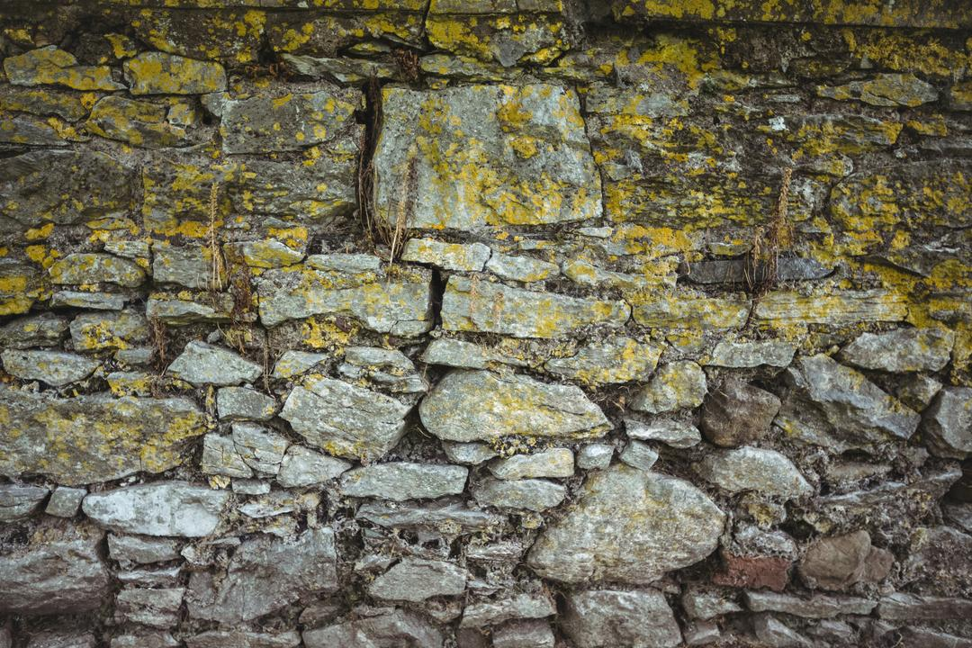 Old stone wall background, full frame