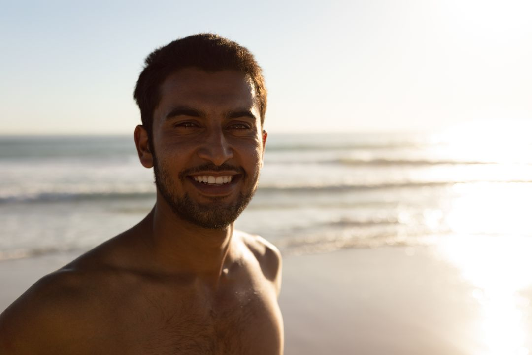 Portrait of happy man standing on the beach