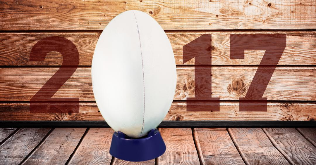 Digital composite image of rugby ball forming 2017 against wooden background