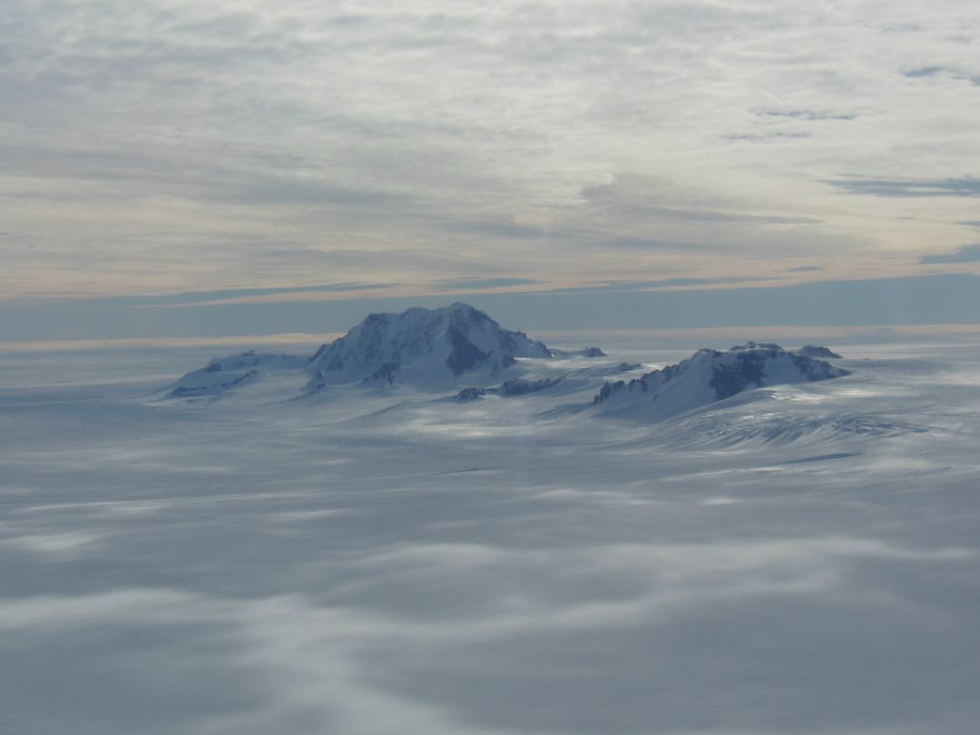 "Mountains seen from the IceBridge DC-8 during a survey of the Getz Ice Shelf on Oct. 27, 2012.  Credit: NASA / Christy Hansen  NASA's Operation IceBridge is an airborne science mission to study Earth's polar ice. For more information about IceBridge, visit: <a href=""http://www.nasa.gov/icebridge"" rel=""nofollow"">www.nasa.gov/icebridge</a>  <b><a href=""http://www.nasa.gov/audience/formedia/features/MP_Photo_Guidelines.html"" rel=""nofollow"">NASA image use policy.</a></b>  <b><a href=""http://www.nasa.gov/centers/goddard/home/index.html"" rel=""nofollow"">NASA Goddard Space Flight Center</a></b> enables NASA's mission through four scientific endeavors: Earth Science, Heliophysics, Solar System Exploration, and Astrophysics. Goddard plays a leading role in NASA's accomplishments by contributing compelling scientific knowledge to advance the Agency's mission.  <b>Follow us on <a href=""http://twitter.com/NASA_GoddardPix"" rel=""nofollow"">Twitter</a></b>  <b>Like us on <a href=""http://www.facebook.com/pages/Greenbelt-MD/NASA-Goddard/395013845897?ref=tsd"" rel=""nofollow"">Facebook</a></b>  <b>Find us on <a href=""http://instagrid.me/nasagoddard/?vm=grid"" rel=""nofollow"">Instagram</a></b>"