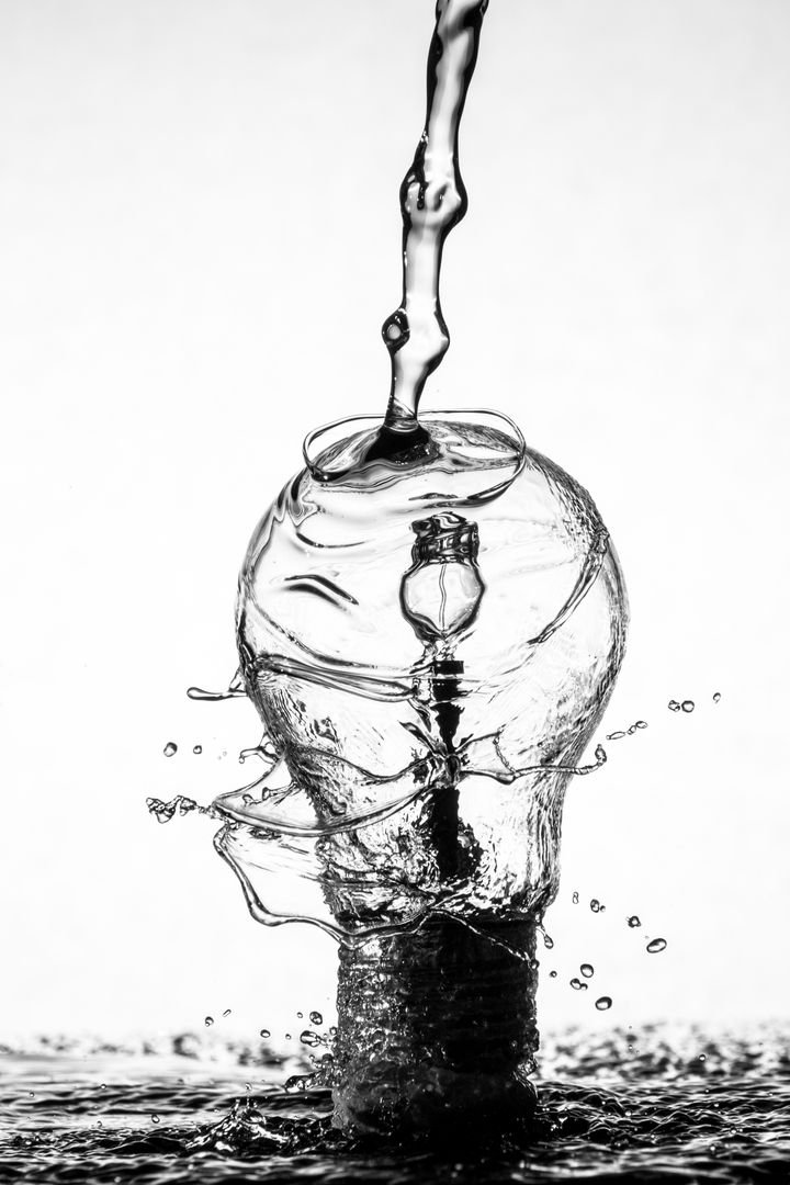Water Drip on Clear Glass Light Bulb