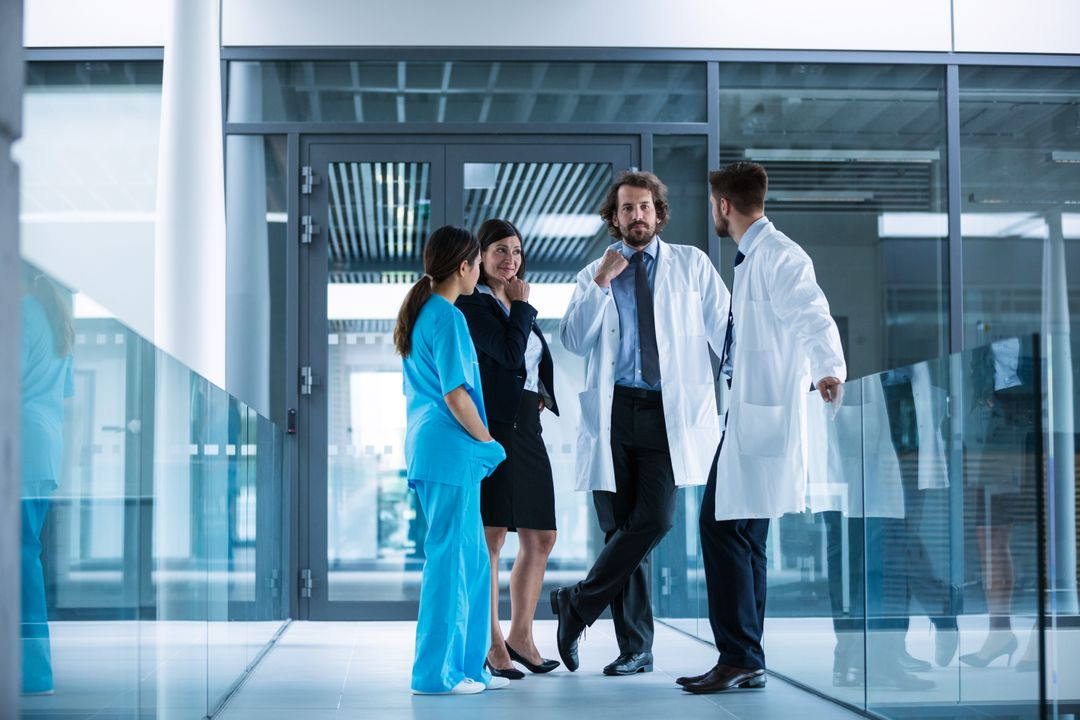 Businesswoman interacting with doctors in hospital Free Stock Images from PikWizard