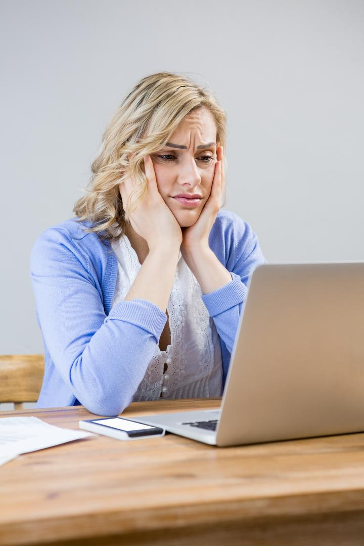 Stressed woman using laptop at home Free Stock Images from PikWizard