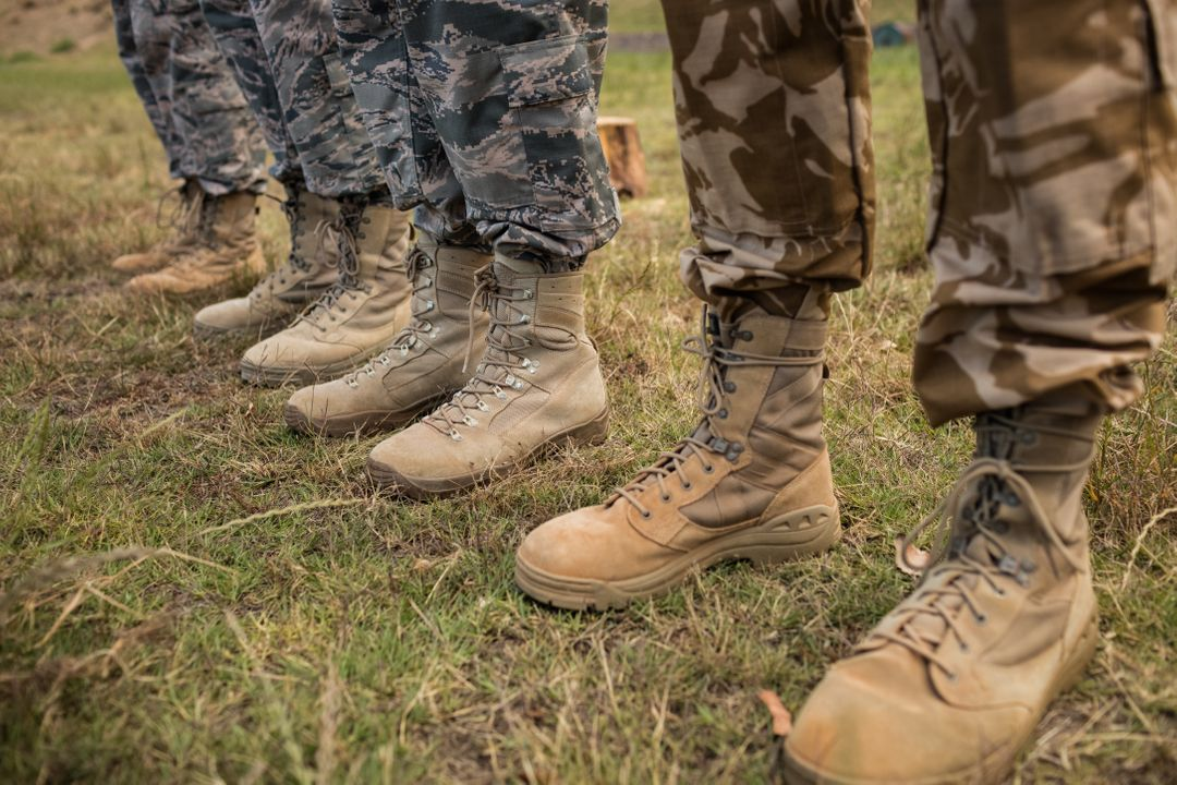 Low-section of military soldiers standing in line at boot camp Free Stock Images from PikWizard