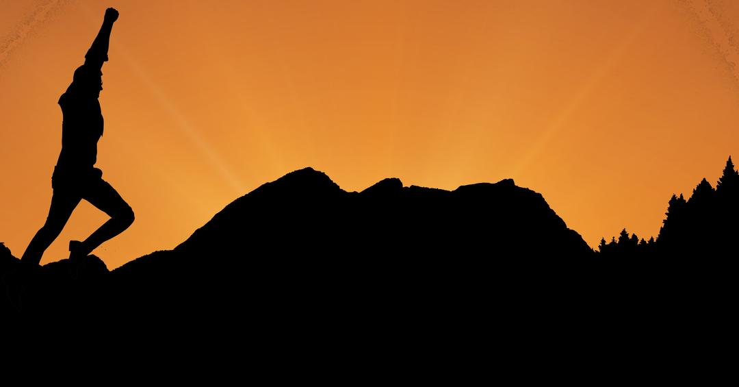 Digital composite of Silhouette businessman with arm raised running on mountains during sunset
