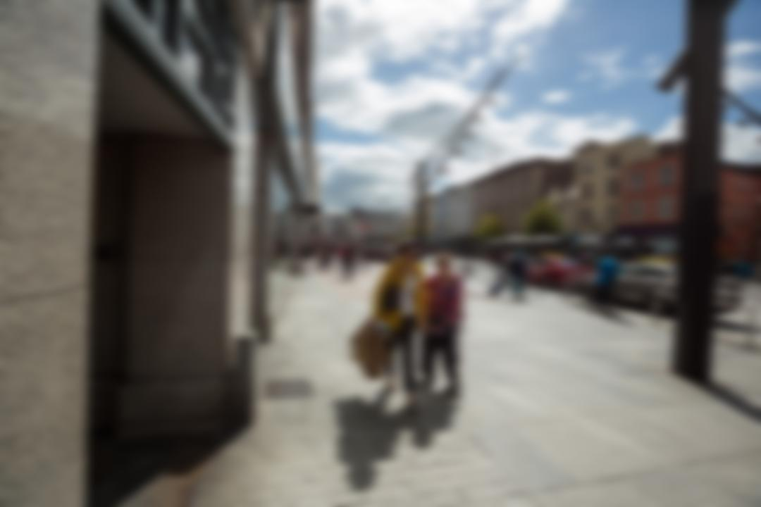 Blur view of pedestrian walking on street on a sunny day Free Stock Images from PikWizard