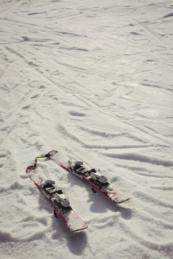 Pair of skis in snow during winter
