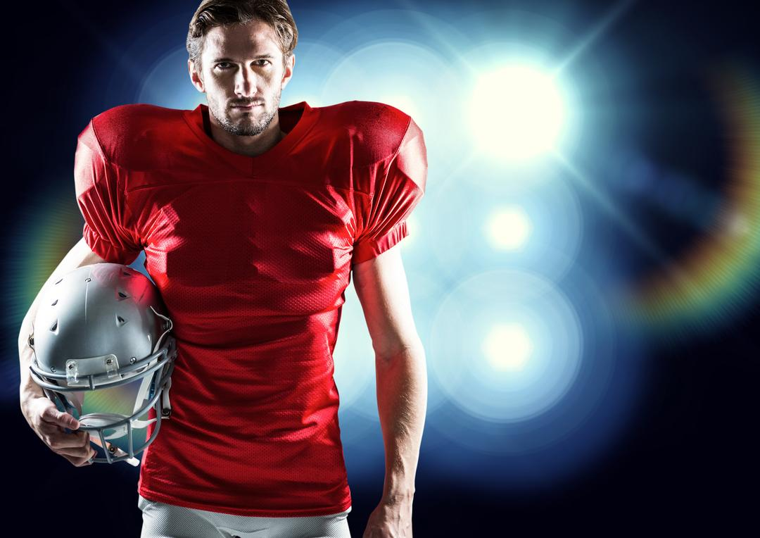 Digital composition of american football player holding helmet against illuminated blue background