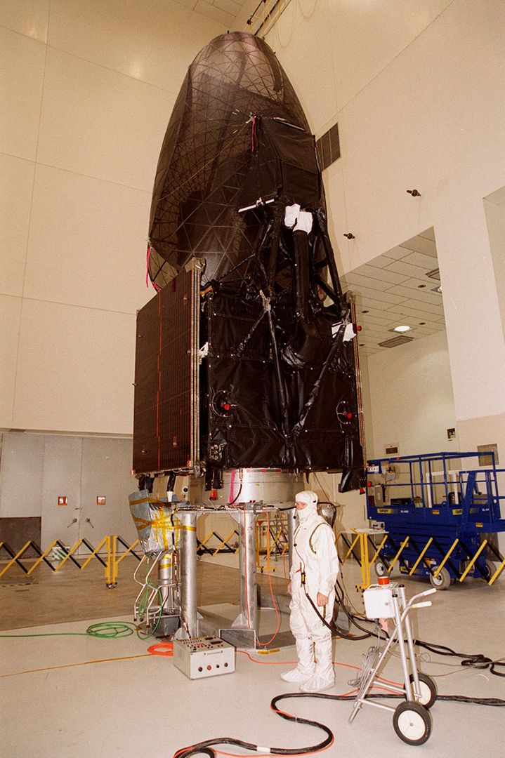 The Tracking and Data Relay Satellite (TDRS-H) sits on a workstand in KSC's Spacecraft Assembly and Encapsulation Facility (SAEF-2) in order to undergo electrical testing. The TDRS is scheduled to be launched from CCAFS June 29 aboard an Atlas IIA/Centaur rocket. One of three satellites (labeled H, I and J) being built in the Hughes Space and Communications Company Integrated Satellite Factory in El Segundo, Calif., the latest TDRS uses an innovative springback antenna design. A pair of 15-foot-diameter, flexible mesh antenna reflectors fold up for launch, then spring back into their original cupped circular shape on orbit. The new satellites will augment the TDRS system's existing Sand Ku-band frequencies by adding Ka-band capability. TDRS will serve as the sole means of continuous, high-data-rate communication with the space shuttle, with the International Space Station upon its completion, and with dozens of unmanned scientific satellites in low earth orbit