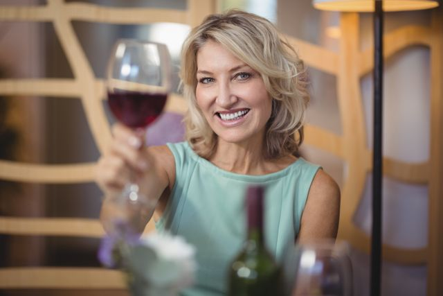 Portrait of mature woman holding a wine glass
