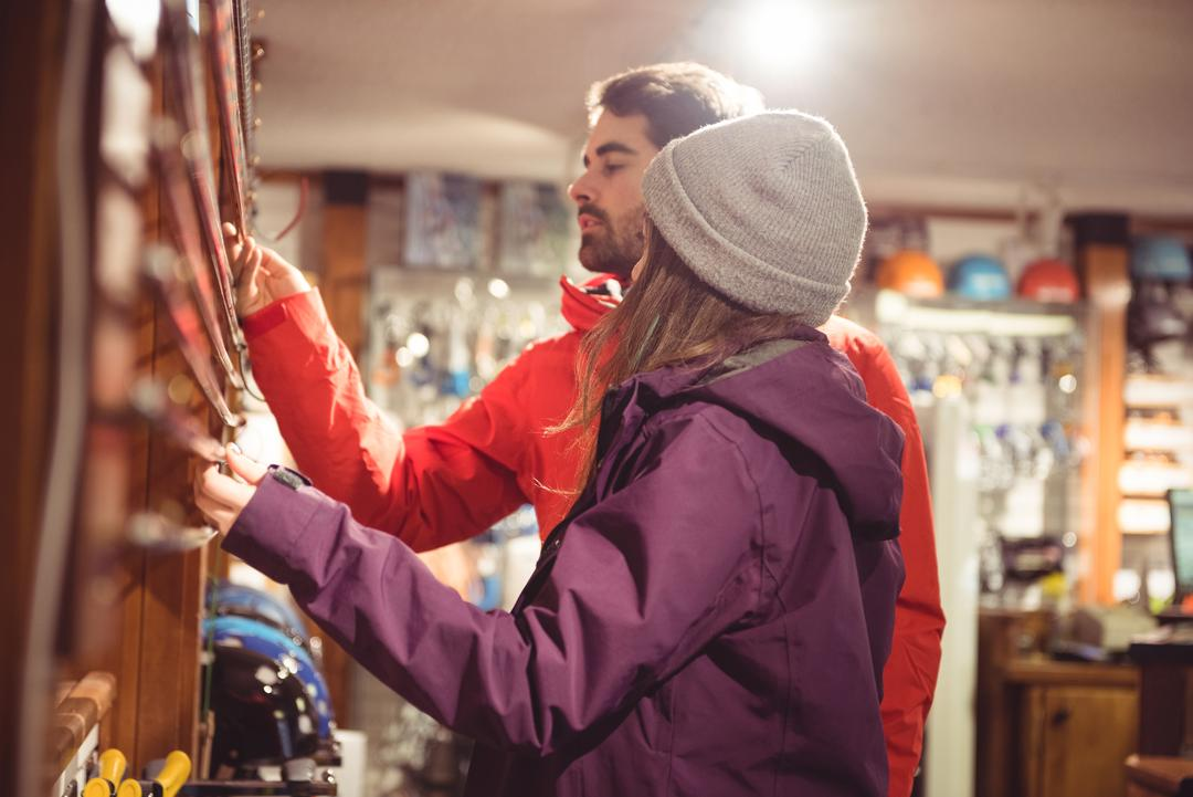 Couple selecting ski pole together in a shop Free Stock Images from PikWizard
