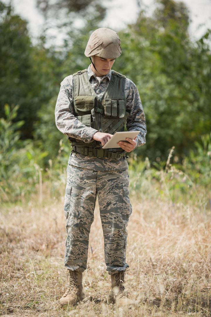 Military soldier using digital tablet in boot camp Free Stock Images from PikWizard