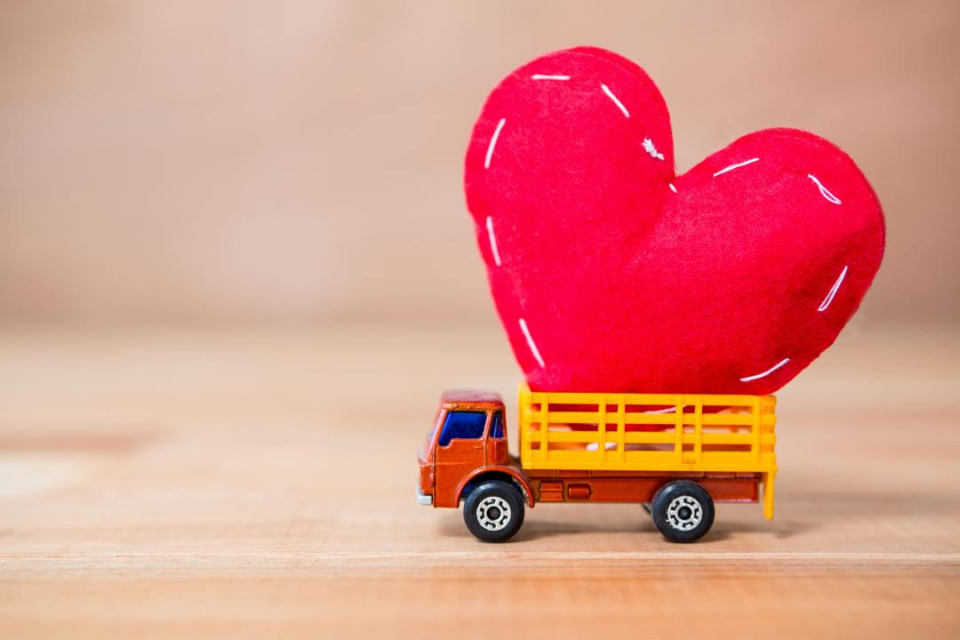 Conceptual image of miniature truck laded with heart