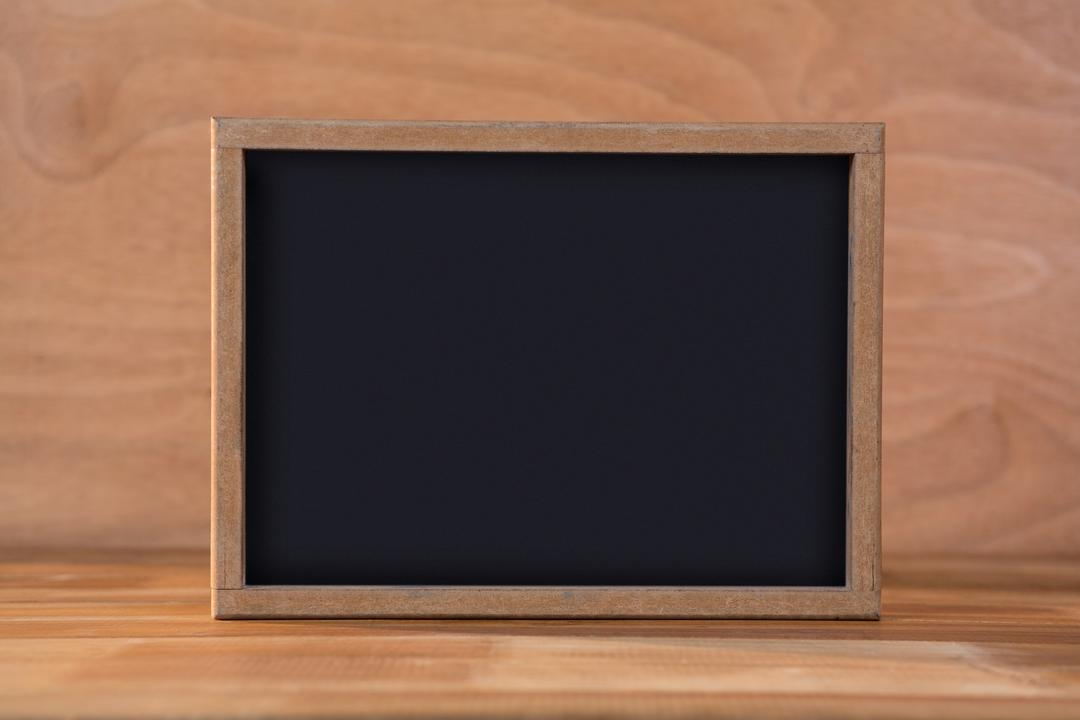 Close-up of blank chalkboard on a table