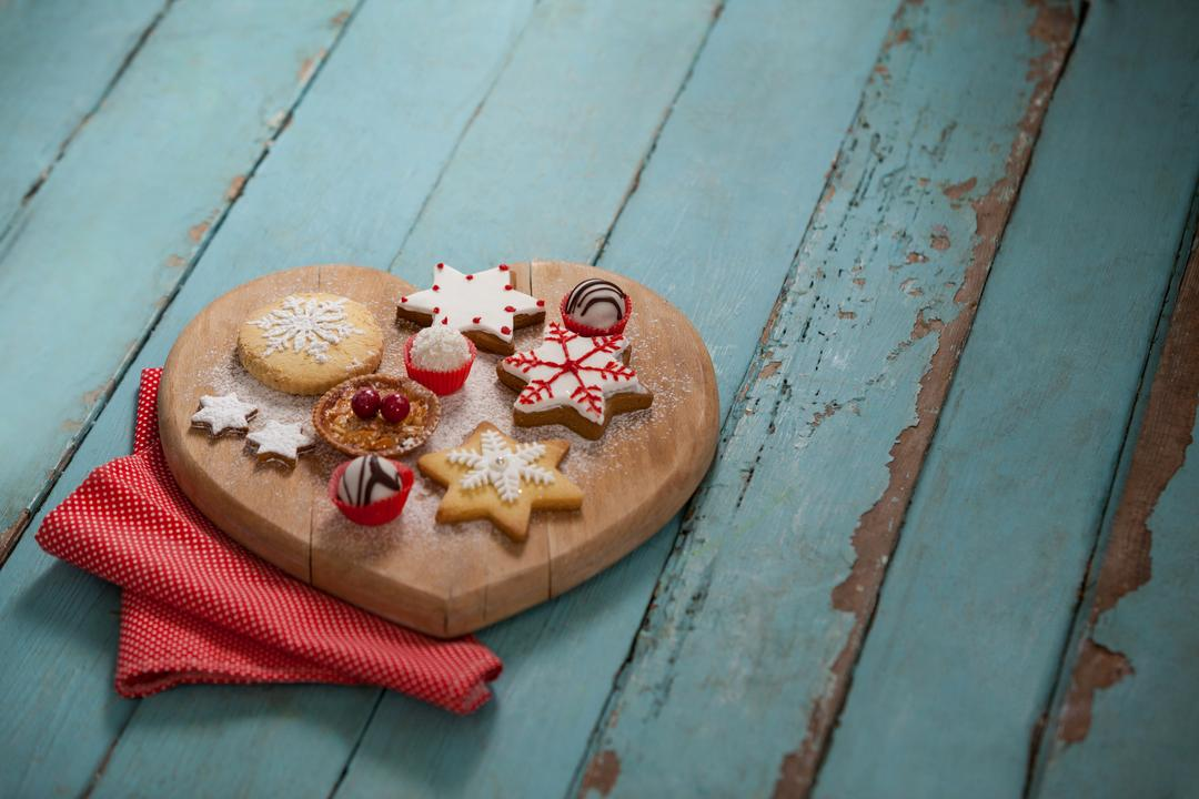 Christmas gingerbread cookies with icing on wooden table