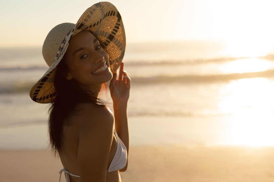 Portrait of woman in hat standing on the beach
