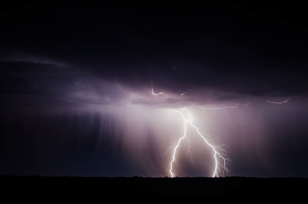 Image of the Sky at Night While Lightning Strikes