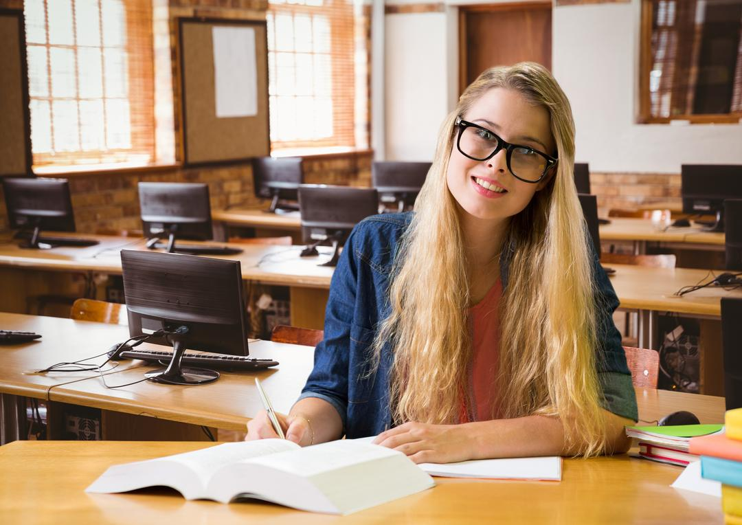 Portrait of girl in spectacles studying in classroom