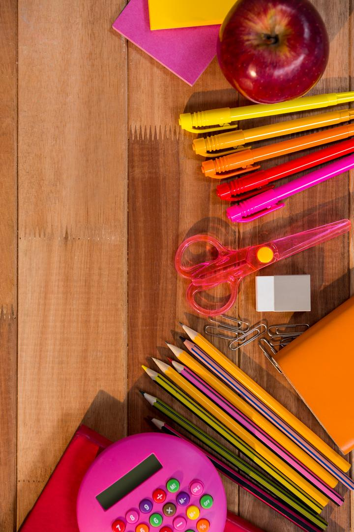 Close-up of school essentials arranged on wooden table