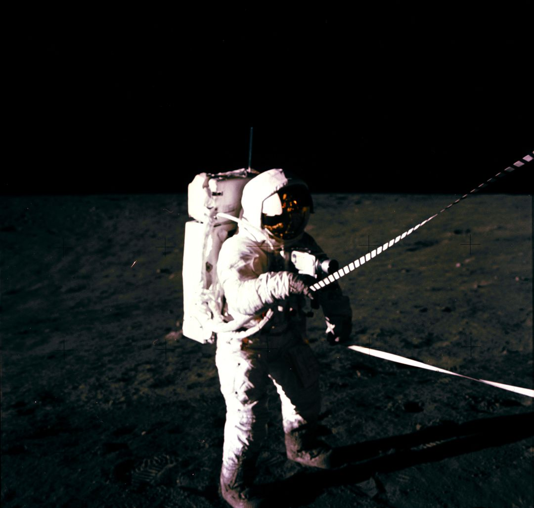 Astronaut Charles Conrad Jr., commander, uses the lunar equipment conveyer (LEC) at the Lunar Module during the Apollo 12 extravehicular activity on the lunar surface. This photograph was taken by Astronaut Alan L. Bean, lunar module pilot.
