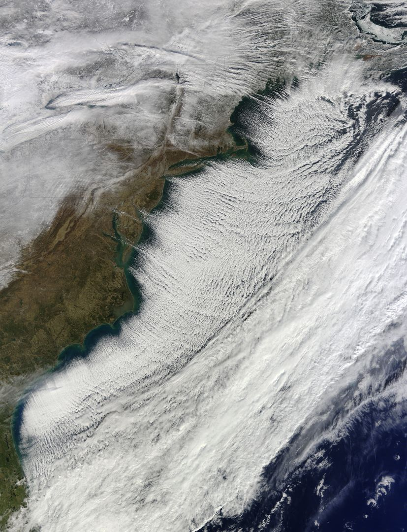 "In the midst of a cold snap that sent temperatures 20–40°F (11–22°C) below normal across much of the United States, the Moderate Resolution Imaging Spectroradiometer (MODIS) on the Terra satellite captured this image of cloud streets over the Atlantic Ocean on January 7, 2014. Cloud streets—long parallel bands of cumulus clouds—form when cold air blows over warmer waters and a warmer air layer (or temperature inversion) rests over the top of both.  The comparatively warm water gives up heat and moisture to the cold air above, and columns of heated air called thermals naturally rise through the atmosphere. The temperature inversion acts like a lid, so when the rising thermals hit it, they roll over and loop back on themselves, creating parallel cylinders of rotating air. As this happens, the moisture cools and condenses into flat-bottomed, fluffy-topped cumulus clouds that line up parallel to the direction of the prevailing wind. On January 7, the winds were predominantly out of the northwest.  Cloud streets can stretch for hundreds of kilometers if the land or water surface underneath is uniform. Sea surface temperature need to be at least 40°F (22°C) warmer than the air for cloud streets to form.  More info: <a href=""http://earthobservatory.nasa.gov/NaturalHazards/view.php?id=82800"" rel=""nofollow"">earthobservatory.nasa.gov/NaturalHazards/view.php?id=82800</a>  NASA Earth Observatory image courtesy Jeff Schmaltz LANCE/EOSDIS MODIS Rapid Response Team, GSFC. Caption by Adam Voiland.  Instrument:  Terra - MODIS  Credit: <b><a href=""http://www.earthobservatory.nasa.gov/"" rel=""nofollow""> NASA Earth Observatory</a></b>  <b><a href=""http://www.nasa.gov/audience/formedia/features/MP_Photo_Guidelines.html"" rel=""nofollow"">NASA image use policy.</a></b>  <b><a href=""http://www.nasa.gov/centers/goddard/home/index.html"" rel=""nofollow"">NASA Goddard Space Flight Center</a></b> enables NASA's mission through four scientific endeavors: Earth Science, Heliophysics, Solar System Exploration, and Astrophysics. Goddard plays a leading role in NASA's accomplishments by contributing compelling scientific knowledge to advance the Agency's mission.  <b>Follow us on <a href=""http://twitter.com/NASA_GoddardPix"" rel=""nofollow"">Twitter</a></b>  <b>Like us on <a href=""http://www.facebook.com/pages/Greenbelt-MD/NASA-Goddard/395013845897?ref=tsd"" rel=""nofollow"">Facebook</a></b>  <b>Find us on <a href=""http://instagram.com/nasagoddard?vm=grid"" rel=""nofollow"">Instagram</a></b> Free Stock Images from PikWizard"
