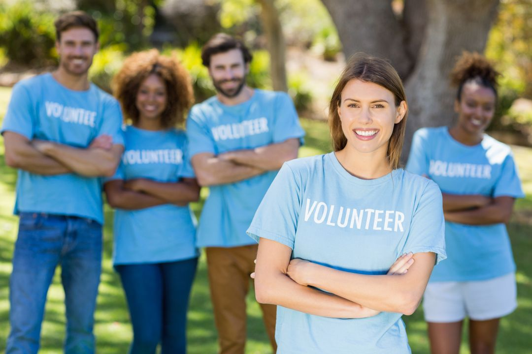 Portrait of volunteer group posing in park Free Stock Images from PikWizard