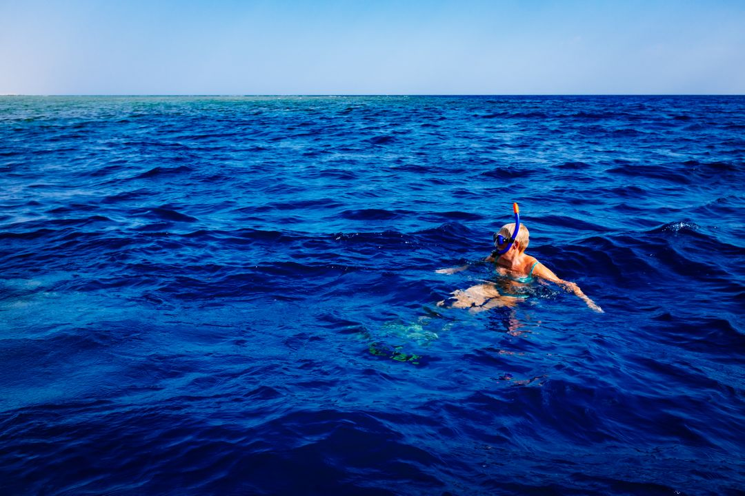 Image of a Person who Is Diving in the Sea