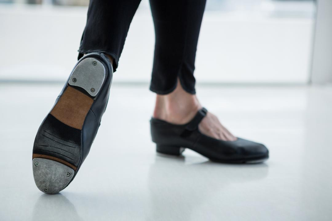 Close-up of dancer wearing tap shoes in the studio Free Stock Images from PikWizard