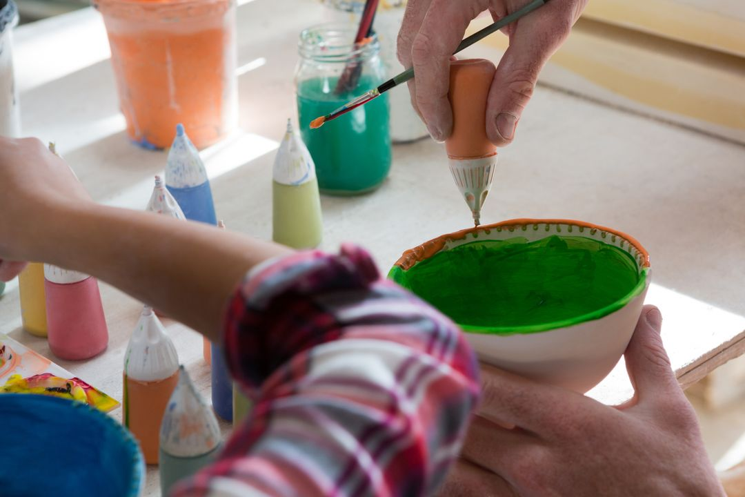 Male potter and girl painting bowl in pottery workshop Free Stock Images from PikWizard