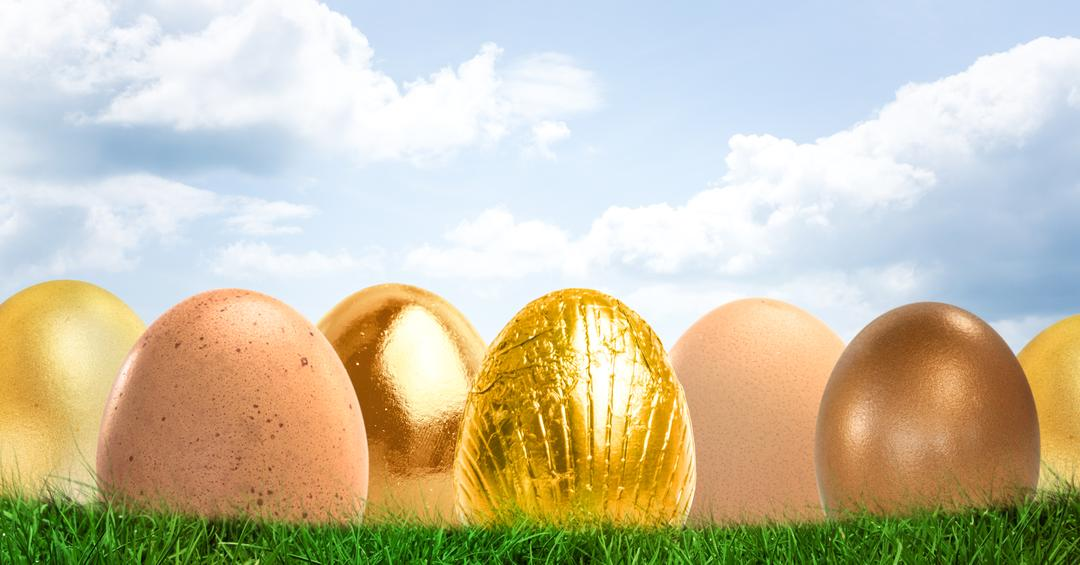 Digital composite of Gold Easter eggs in front of blue sky Free Stock Images from PikWizard