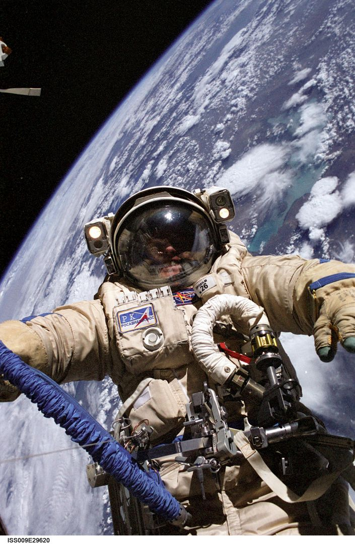 ISS009-E-29620 (3 August 2004) --- Astronaut Edward M. (Mike) Fincke, Expedition 9 NASA ISS science officer and flight engineer, wearing a Russian Orlan spacesuit, participates in the third of four sessions of extravehicular activities (EVA) performed by the Expedition 9 crew during their six-month mission. Fincke and cosmonaut Gennady I. Padalka (out of frame), commander representing Russia's Federal Space Agency, spent 4 ½ hours outside the Station swapping out experiments and installing hardware associated with Europe's Automated Transfer Vehicle (ATV), scheduled to launch on its maiden voyage to ISS next year. A cloudy Earth provided the backdrop for the image.