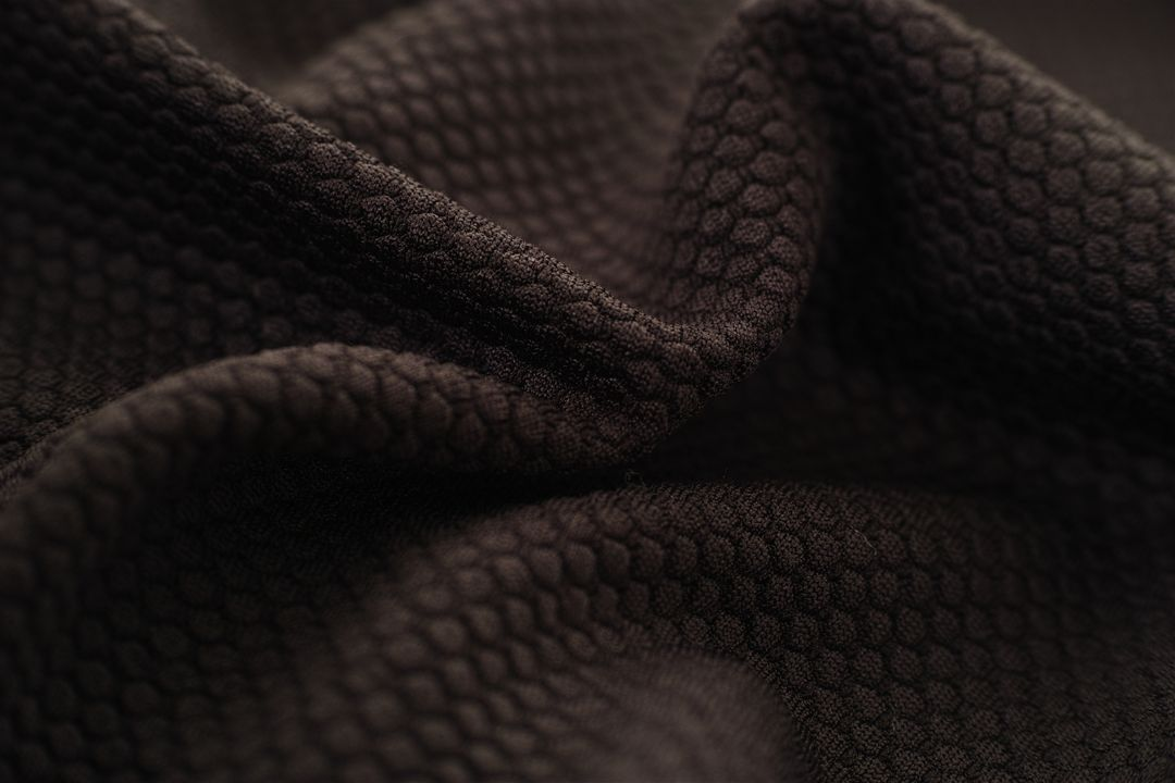 Closeup dark brown copy detail fabric