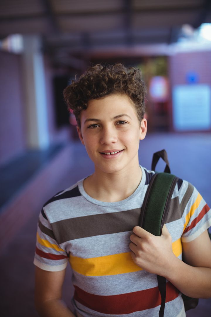 Portrait of happy schoolboy standing in school campus Free Stock Images from PikWizard