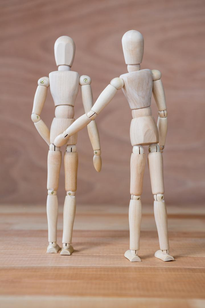 Conceptual image of figurine couple standing together