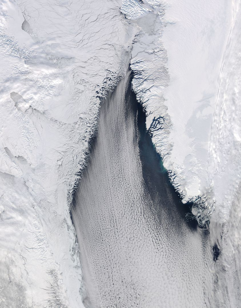 "The late winter sun shone brightly on a stunning scene of clouds and ice in the Davis Strait in late February, 2013. The Moderate Resolution Imaging Spectroradiometer aboard NASA's Aqua satellite captured this true-color image on February 22 at 1625 UTC.  The Davis Strait connects the Labrador Sea (part of the Atlantic Ocean) in the south with Baffin Bay to the north, and separates Canada, to the west, from Greenland to the east.  Strong, steady winds frequently blow southward from the colder Baffin Bay to the warmer waters of the Labrador Sea. Over ice, the air is dry and no clouds form. However, as the Arctic air moves over the warmer, open water the rising moist air and the temperature differential gives rise to lines of clouds. In this image, the clouds are aligned in a beautiful, parallel pattern. Known as ""cloud streets"", this pattern is formed in a low-level wind, with the clouds aligning in the direction of the wind.  Credit: NASA/GSFC/Jeff Schmaltz/MODIS Land Rapid Response Team  <b><a href=""http://www.nasa.gov/audience/formedia/features/MP_Photo_Guidelines.html"" rel=""nofollow"">NASA image use policy.</a></b>  <b><a href=""http://www.nasa.gov/centers/goddard/home/index.html"" rel=""nofollow"">NASA Goddard Space Flight Center</a></b> enables NASA's mission through four scientific endeavors: Earth Science, Heliophysics, Solar System Exploration, and Astrophysics. Goddard plays a leading role in NASA's accomplishments by contributing compelling scientific knowledge to advance the Agency's mission.  <b>Follow us on <a href=""http://twitter.com/NASA_GoddardPix"" rel=""nofollow"">Twitter</a></b>  <b>Like us on <a href=""http://www.facebook.com/pages/Greenbelt-MD/NASA-Goddard/395013845897?ref=tsd"" rel=""nofollow"">Facebook</a></b>  <b>Find us on <a href=""http://instagram.com/nasagoddard?vm=grid"" rel=""nofollow"">Instagram</a></b>"