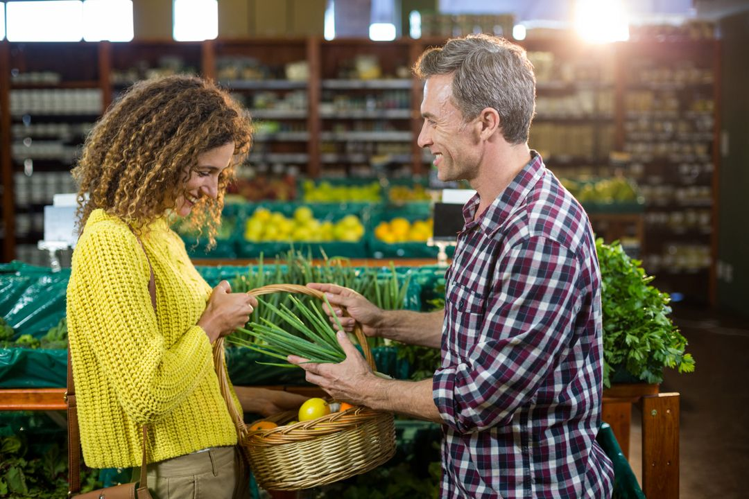 Happy couple buying vegetables in organic section of supermarket Free Stock Images from PikWizard