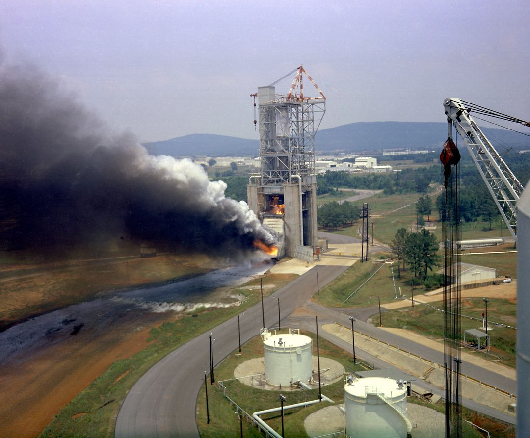 This photograph depicts a test firing of an F-1 engine at the F-1 engine test stand in the west test area of the Marshall Space Flight Center. This engine produced 1,500,000 pounds of thrust using liquid oxygen and RP-1, which is a derivative of kerosene. The F-1 engine test stand was constructed in 1963 to assist in the development of the F-1 engine.