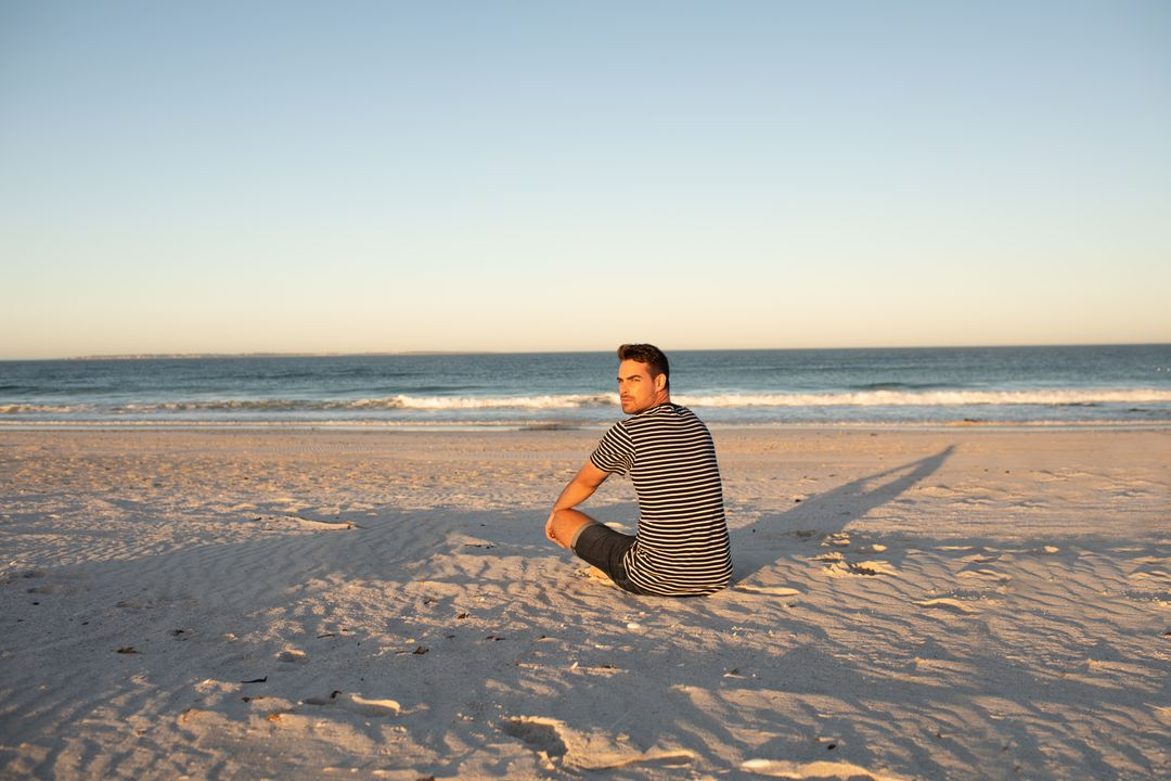 Rear view of man relaxing on the beach