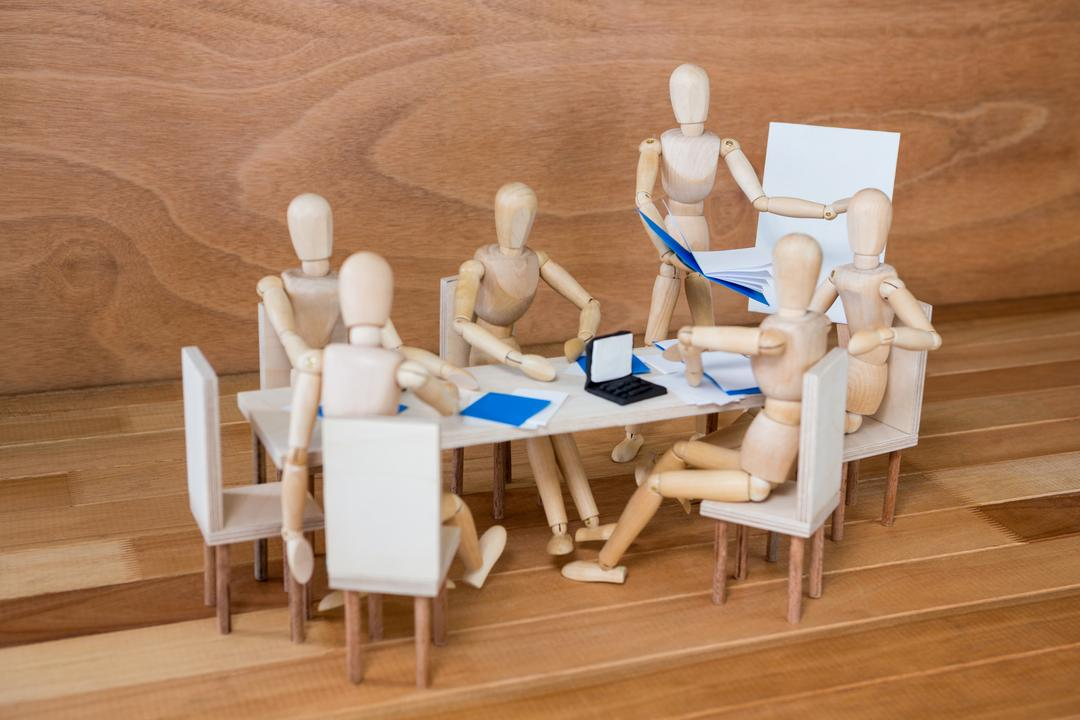 Conceptual image of figurine attending a business meeting in the conference room