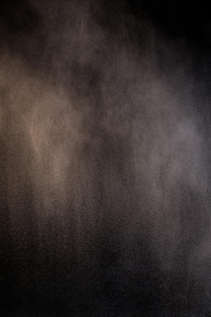 Splashing of dust powder on black background Free Stock Images from PikWizard