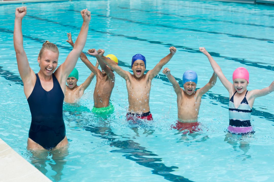 Cheerful female instructor with children enjoying in swimming pool Free Stock Images from PikWizard