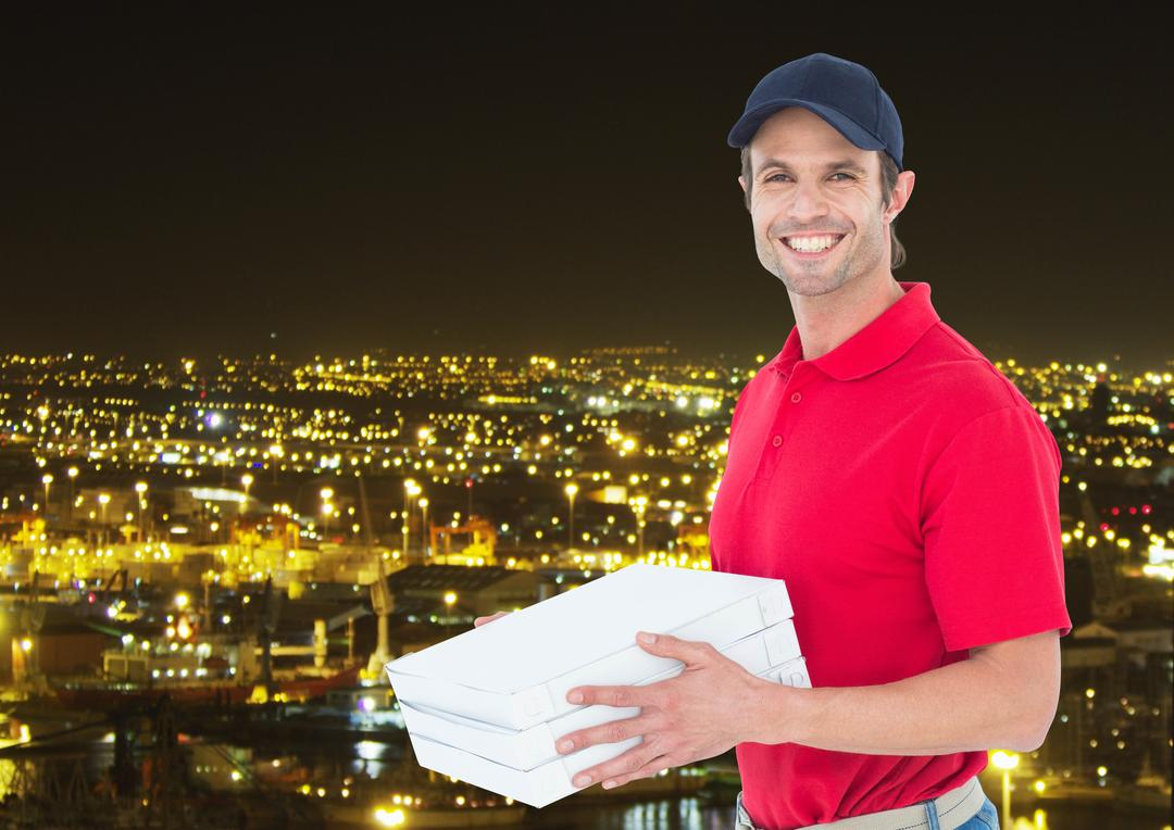 Digital composite of Happy deliveryman with pizza boxes in the city at night Free Stock Images from PikWizard