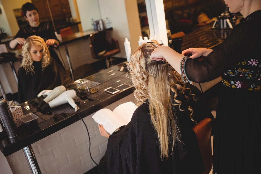 Female hairdresser styling clients hair in saloon Free Stock Images from PikWizard