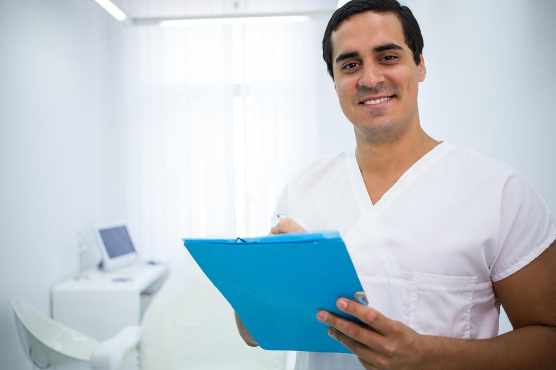 Portrait of smiling doctor holding a medical file Free Stock Images from PikWizard