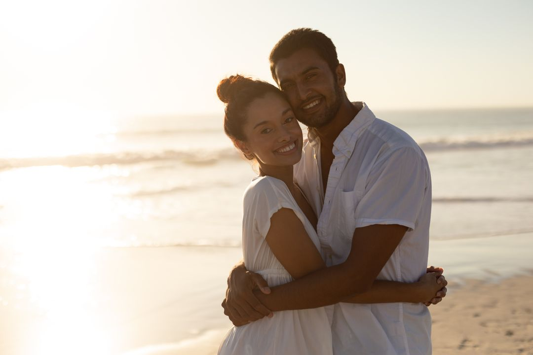 Portrait of happy couple embracing each other on the beach