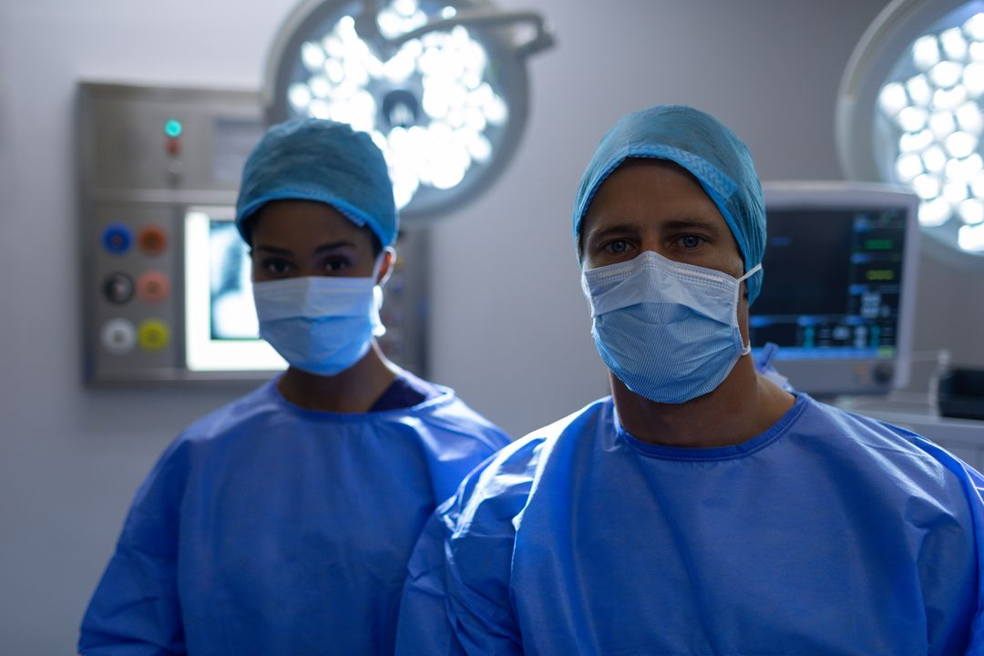 Surgeons standing together in operation theater at hospital
