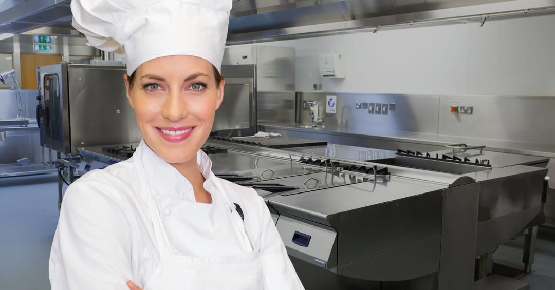 Digital composite image of female chef standing with arms crossed in commercial kitchen